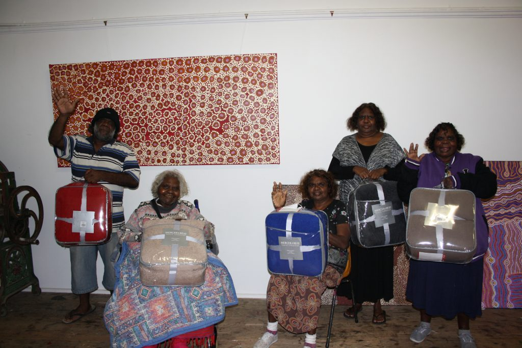 Artists with their new donated blankets!