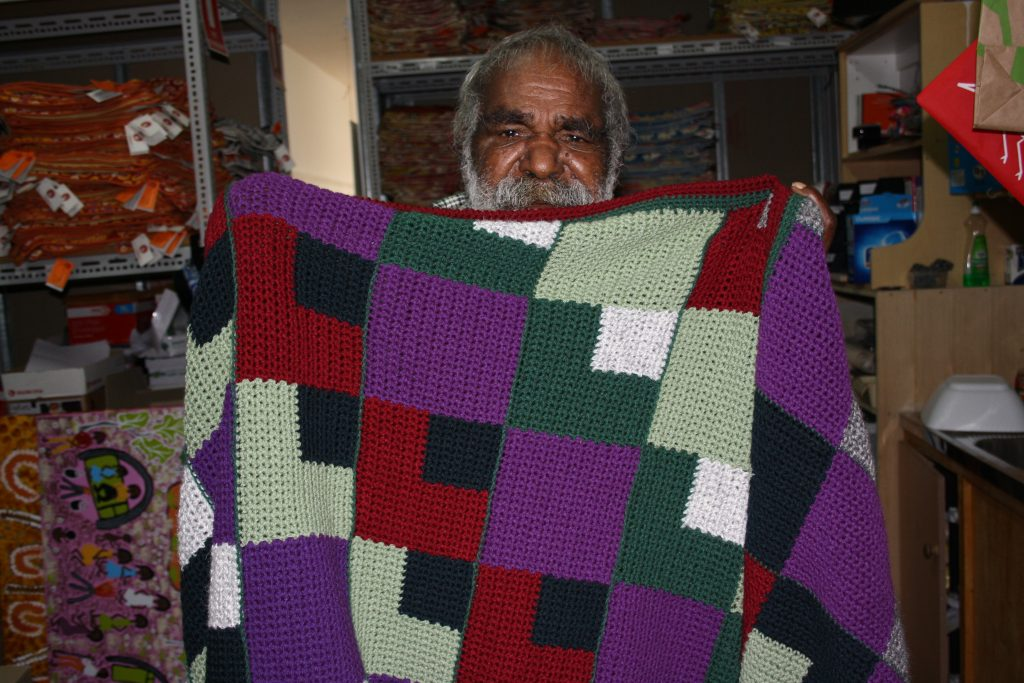 Rama with his new blanket, knitted and donated